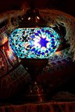 Turkish mosaic lamp surrounded by carpet Royalty Free Stock Photos
