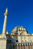 Turkish mosque with high minaret Stock Photos