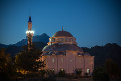 Turkish Mosque at night. Turkish Mosque, Cirali south west Turkey. With Mount Olympos in the background. Shot at dusk Stock Image