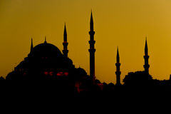 Turkish mosque silhouette of minarets at sunset Stock Image