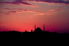 Turkish mosque at sunset violet sky light stock photos