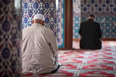 Turkish Muslims in a mosque in Side, Turkey. Turkish Muslims pray in a mosque in Side, Turkey Stock Photo