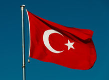 Turkish national flag over blue sky Royalty Free Stock Image