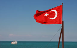 Turkish National Flag waving on the wind. Stock Photos