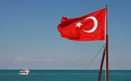 Turkish National Flag waving on the wind. Turkish National Flag waiving on the wind on Mediterranean Sea in Kemer (Antalya), Turkey Stock Photos