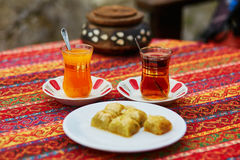 Turkish orange and black tea in traditional glasses and baklava Royalty Free Stock Photos