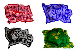 Turkish Oriental beautiful scarves with pictures of natural silk on a white background. Colorful Turkish Oriental beautiful scarves with pictures of natural silk royalty free stock images