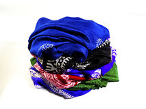Turkish Oriental beautiful scarves with pictures of natural silk on a white background. Colorful Turkish Oriental beautiful scarves with pictures of natural silk royalty free stock photography