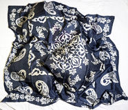Turkish Oriental beautiful scarves with pictures of natural silk on a white background. Colorful Turkish Oriental beautiful scarves with pictures of natural silk royalty free stock photo