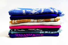 Turkish Oriental beautiful scarves with pictures of natural silk on a white background. Colorful Turkish Oriental beautiful scarves with pictures of natural silk stock photo