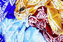 Turkish Oriental beautiful scarves with pictures of natural silk on a white background. Colorful Turkish Oriental beautiful scarves with pictures of natural silk stock images