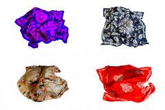 Turkish Oriental beautiful scarves with pictures of natural silk on a white background. Colorful Turkish Oriental beautiful scarves with pictures of natural silk stock photography