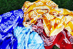 Turkish Oriental beautiful scarves with pictures of natural silk on a white background. Colorful Turkish Oriental beautiful scarves with pictures of natural silk royalty free stock photos