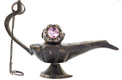 Turkish Ottoman ring. Turkish Ottoman silver and gold vintage ring with amethyst on antique oil lamp Stock Images