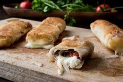 Turkish Pacanga Boregi with pastirma and cheddar melted cheese / borek Royalty Free Stock Image