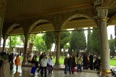 Turkish palace humans sightseeing. Tourists sightseeing in Topkapi palace courtyard.Istanbul,Turkey.Picture taken on May 9th,2014 Royalty Free Stock Photo