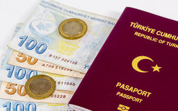 Turkish Passport, Banknotes, and some Change. Turkish passport, banknotes and coins on white background - travel and finance concept stock photos