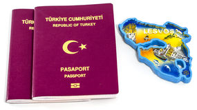 Turkish Passports and Lesvos Island. Two Turkish passports and magnet of Lesvos island on white background - travel concept stock image