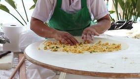 Turkish pastry gozleme. Woman making pancakes, traditional Turkish food (gozleme stock video
