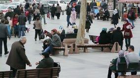 Turkish People in Istanbul. Istanbul, Turkey – February 2, 2013: Turkish people in Eminonu Square stock video footage
