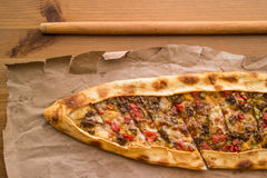 Turkish pide with cheese and cubed meat / kusbasili kasarli pide Royalty Free Stock Photo