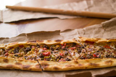 Turkish pide with cheese and cubed meat / kusbasili kasarli pide Stock Photo