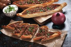 Turkish pide, traditional meal similar to pizza Stock Photography