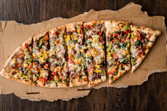 Turkish Pide with meat and vegetables. Stock Photos