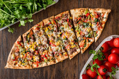 Turkish Pide with meat and vegetables. Royalty Free Stock Photo