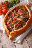 Turkish pide pizza with beef and vegetables close-up vertical Royalty Free Stock Image