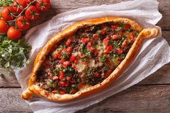 Turkish pide pizza with meat closeup. horizontal view from above Royalty Free Stock Image