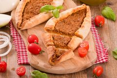 Turkish pide pizza with meat and onion. Stock Image