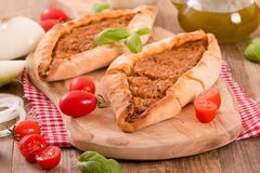 Turkish pide pizza with meat and onion. Stock Photos