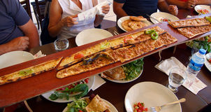 Turkish Pide are served on long planks Royalty Free Stock Photo