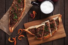Turkish pide, traditional meal similar to pizza Royalty Free Stock Images