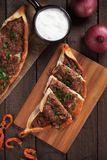 Turkish pide, traditional meal similar to pizza Royalty Free Stock Photo