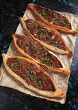 Turkish pide, traditional meal similar to pizza. Turkish pide, traditional meat and vegetable meal similar to pizza Royalty Free Stock Photo