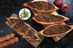 Turkish pide, traditional meal similar to pizza. Turkish pide, traditional meat and vegetables meal similar to pizza stock photography