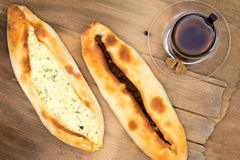 Turkish pides wth cheese and beef and hot tea Royalty Free Stock Image