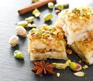 Turkish pistachio pastry dessert  baklava with green pistachios Stock Photo