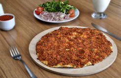 Turkish pizza. Lahmacun (Turkish pizza) on table with salad and buttermilk Royalty Free Stock Photo