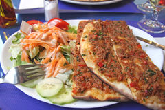 Turkish pizza. On plate with mixed salad Royalty Free Stock Photos