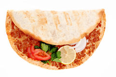 Turkish Pizza Lahmacun. Delicious Turkish pizza lahmacun on isolated background Royalty Free Stock Images