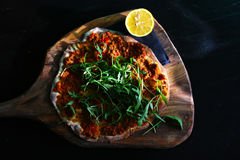 Turkish pizza lahmacun of minced meat and bell peppers Royalty Free Stock Image