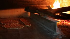 Turkish Pizza Lahmacun and pide cooking in wooden oven stock video