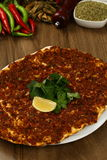 Turkish Pizza - Lahmacun. With salad and spices Royalty Free Stock Images