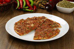 Turkish Pizza - Lahmacun. With vegetables and spices Royalty Free Stock Images