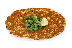Turkish Pizza - Lahmacun. With vegetables and spices on isolated white background Royalty Free Stock Photo