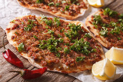 Turkish pizza with meat - lahmacun macro on the table. Horizonta Royalty Free Stock Images
