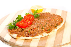 Turkish pizza. On a wooden board Stock Photo